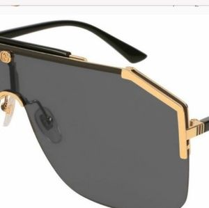 0baff731 Black and Gold Gucci GG0291S Sunglasses